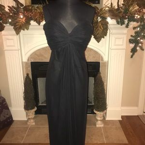 Formal black dress with front bust ruching.